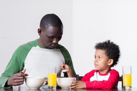 father and son eating breakfast Stock Photo - 89861751
