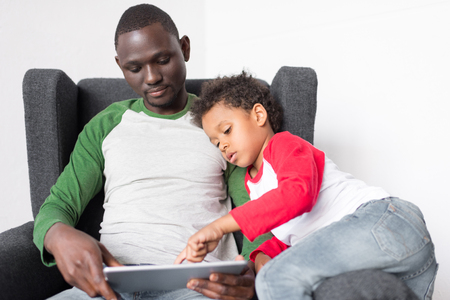 father and son using tablet