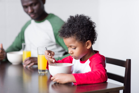father and son eating breakfast Stock Photo - 89817904