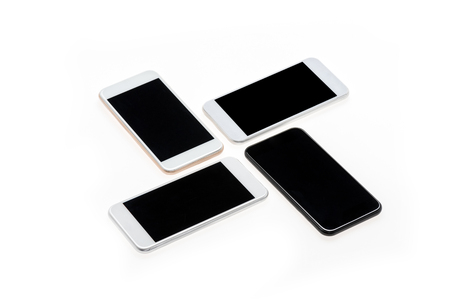 arranged modern smartphones with black screens isolated on white
