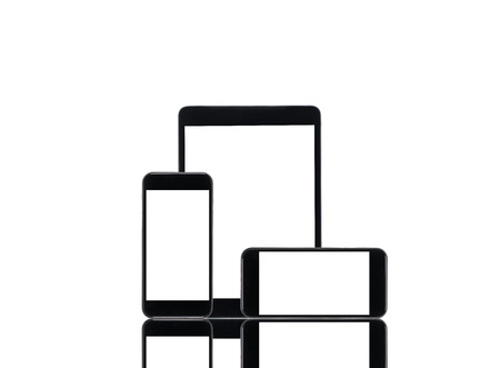 arranged tablet computer and smartphones with blank screens isolated on white
