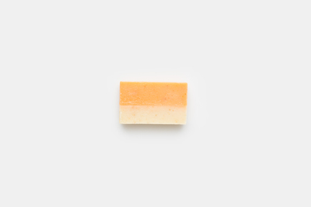 top view of orange handcrafted soap on white surface Stock Photo