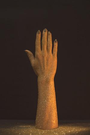 De washand dient gouden in schitteren op zwarte
