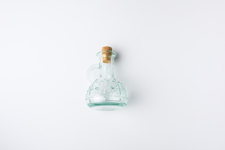 Top view of transparent blue glass bottle with cork isolated on white Фото со стока