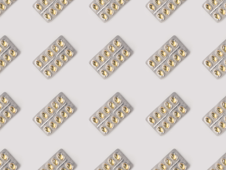 Set of blister packs with yellow pills isolated on white