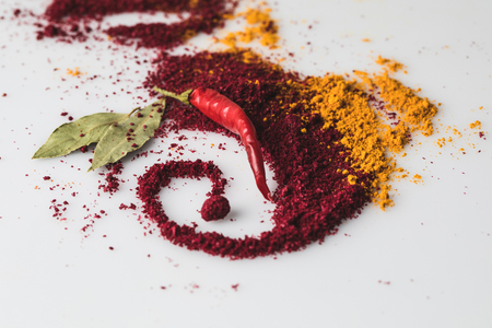 beautiful spices composition of chilli pepper and paprika isolated on white Фото со стока