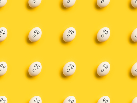 Set of Painted chicken eggs with shocked emoji isolated on yellow