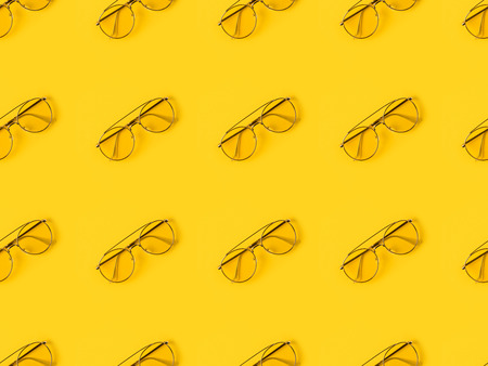 Set of stylish Glasses isolated on yellow Фото со стока