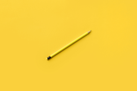 One Yellow pencil isolated on yellow