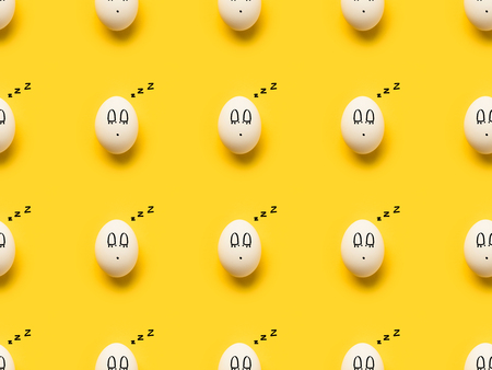 Set of Painted chicken eggs with sleeping smiley on yellow