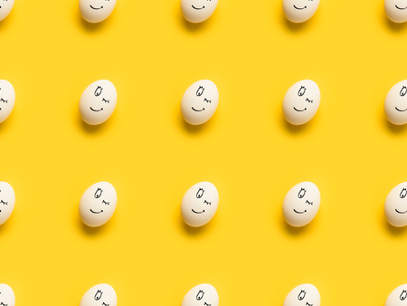 Set of painted eggs with winking emoji isolated on yellow