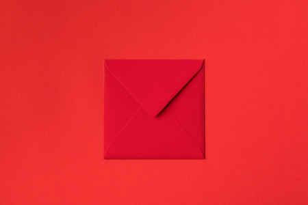 close-up view of decorative festive red envelope isolated on red