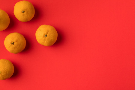 top view of fresh ripe tangerines isolated on red  Banco de Imagens
