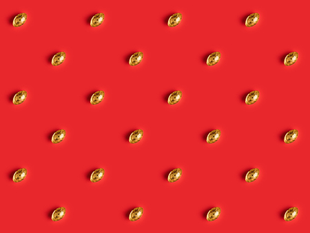 top view of golden ingots pattern on red