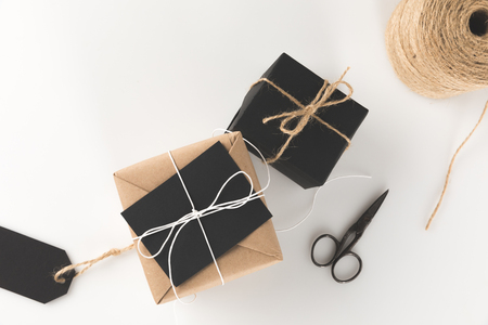 top view of christmas presents, scissors and twine, isolated on white Stock Photo