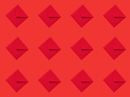 top view of pattern made from festive red envelopes isolated on red Stok Fotoğraf