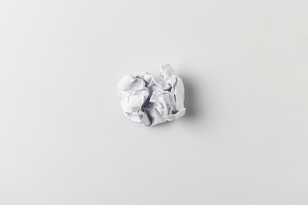 top view of crumpled paper on white surface