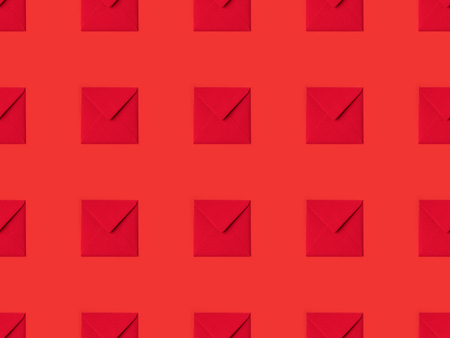 top view of pattern made from red envelopes isolated on red