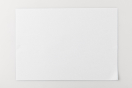top view of blank paper on white surface
