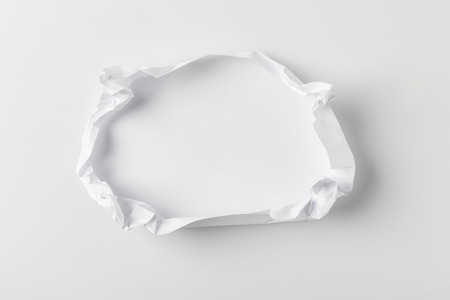 top view of crumpling blank paper on white tabletop