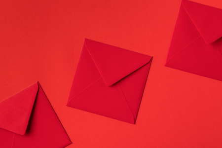 close-up view of decorative festive red envelopes isolated on red