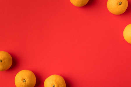 top view of fresh ripe mandarins isolated on red