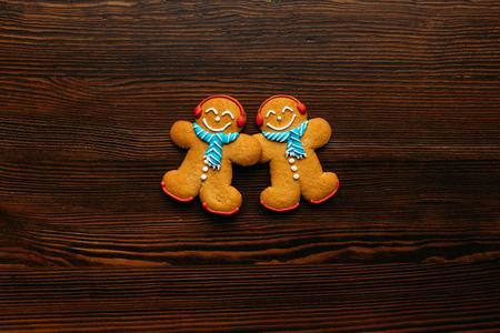 top view of Gingerbread men cookies on wooden tabletop