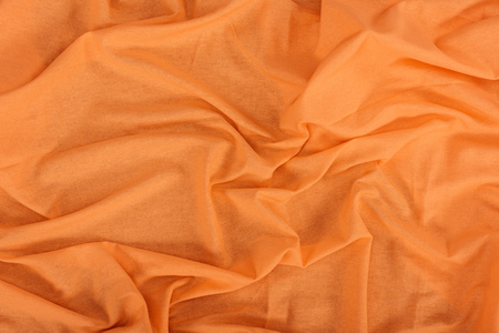 close up view of orange linen fabric texture