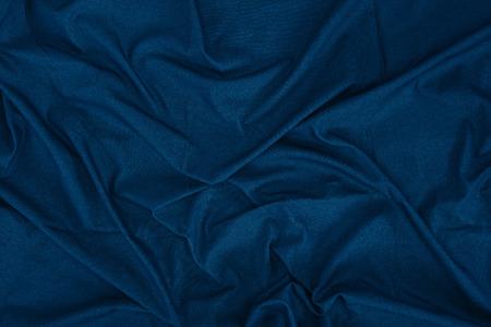 Sluit omhoog mening van de donkerblauwe textuur van de linnestof