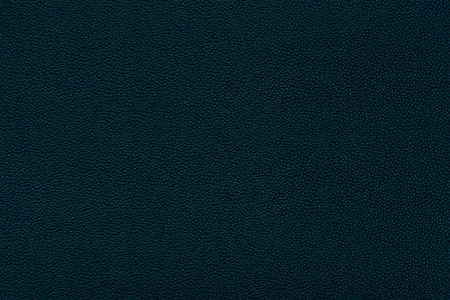 close up view of black leather fabric texture