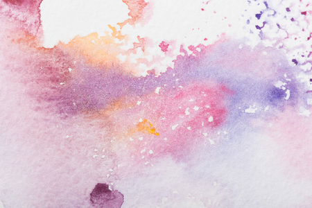 close up view of colorful watercolor stains background