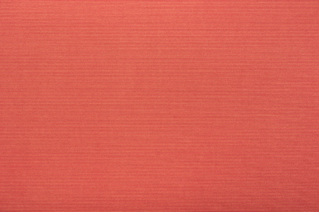 close up view of red velvet fabric texture
