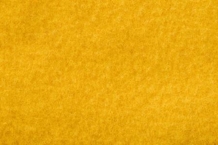 close up view of orange felt texture