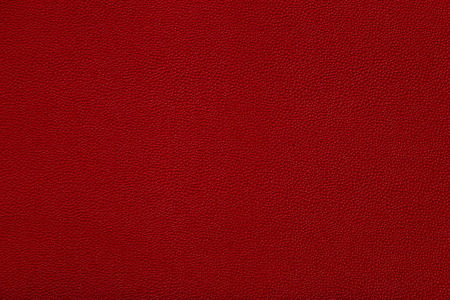 close up view of red leather fabric texture