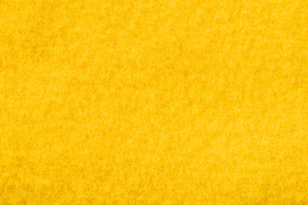 close up view of yellow felt texture