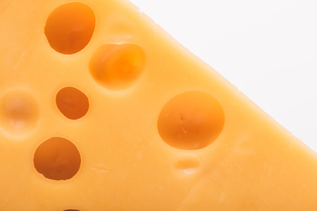 close up view of tasty cheddar cheese isolated on white Stock Photo