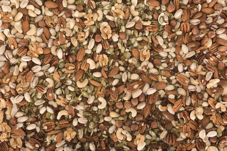 top view of assorted healthy dried nuts background Zdjęcie Seryjne