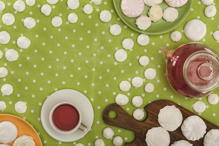 white marshmallows and tea on green polka dot tablecloth