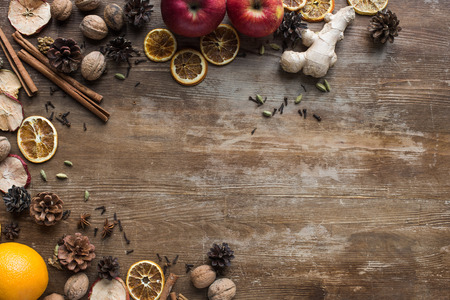 Top view of fresh and dried fruits and spices on a wooden table