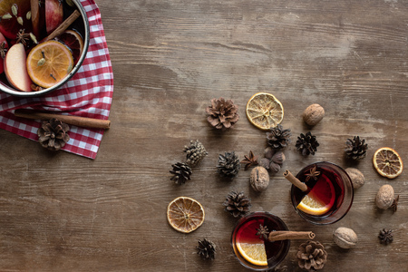 Top view of homemade mulled wine on a wooden surface