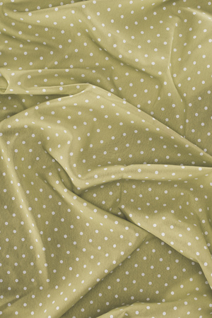 elegant silky fabric with polka dots as background