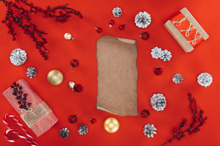 blank papyrus, christmas decorations and presents, isolated on red