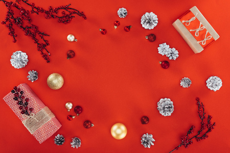 flat lay with Christmas balls, decorations and presents, isolated on red with copy space Zdjęcie Seryjne