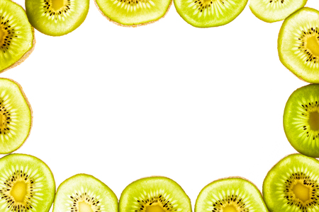 top view of arranged kiwi fruit pieces isolated on white Banco de Imagens