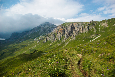 beautiful landscape view of green mountains and cloudy sky