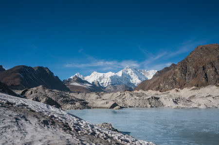 beautiful scenic landscape with snowy mountains and lake Banco de Imagens