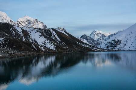 beautiful scenic landscape with snowy mountains and lake Imagens