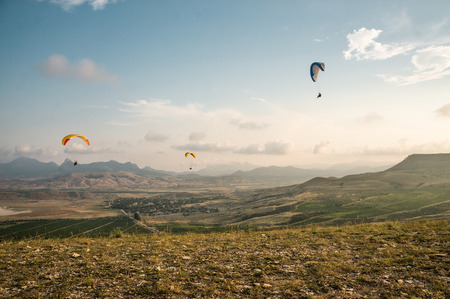 people flying on paragliders sky with clouds on background Zdjęcie Seryjne