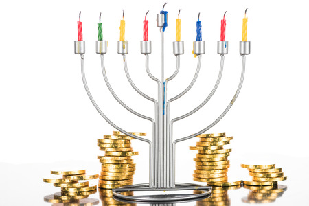 hanukkah celebration with menorah, candles and coins,  isolated on white