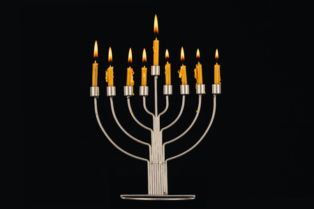 hanukkah celebration with menorah and candles, isolated on black